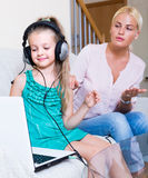 Little girl playing computer game Stock Images