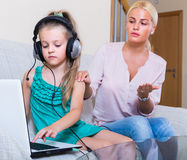Little girl playing computer game Royalty Free Stock Images