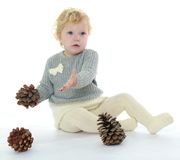 Little girl playing with cones on the floor Stock Photo