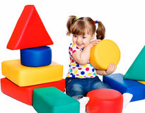Little girl playing in the constructor Stock Images