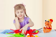 A little girl is playing in the cook royalty free stock photo