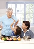 LIttle girl playing cooking with granny and mother Royalty Free Stock Image