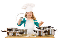 Little girl playing with cooking utensils Stock Photo