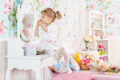 Little girl playing with cosmetics Stock Photo
