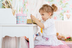 Little girl playing with cosmetics Royalty Free Stock Images
