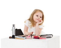 Little girl playing with cosmetics. Royalty Free Stock Photos