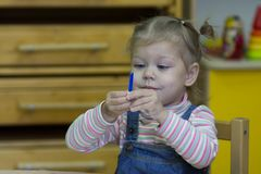 Little girl playing with counting sticks on the arithmetic stock images