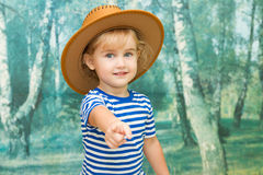 Little girl playing in cowboy Stock Images