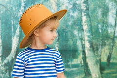 Little girl playing in cowboy Royalty Free Stock Image