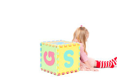 Little girl playing with cube Royalty Free Stock Images