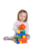 Little girl playing with cubes Stock Photo