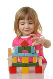 Little girl playing with cubes Royalty Free Stock Photos
