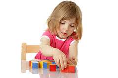 Little girl playing with cubes Stock Photography