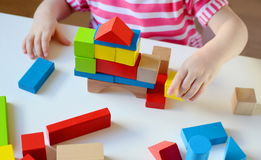 Little girl playing with cubes Royalty Free Stock Photo