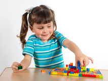 Little girl playing with cubes Stock Photos