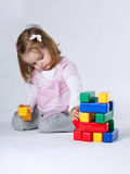 Little girl playing with cubes Royalty Free Stock Image