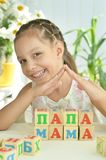 Little girl playing with cubes Royalty Free Stock Images