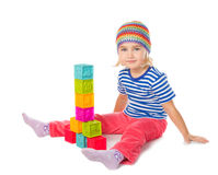 Little girl playing cubes sitting . Royalty Free Stock Photos
