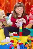 Little girl playing with cubes Stock Images