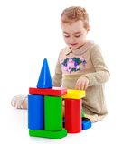 Little girl playing in the cylinders Royalty Free Stock Photography