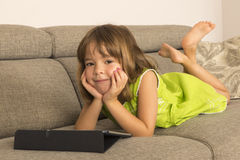 Little girl playing with a digital tablet Stock Photography