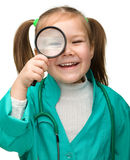 Little girl is playing doctor Royalty Free Stock Images