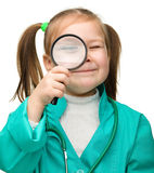 Little girl is playing doctor Royalty Free Stock Photos