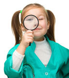 Little girl is playing doctor Royalty Free Stock Photography