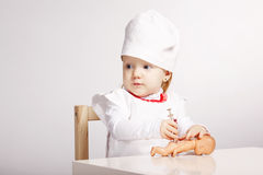 Little girl playing doctor with a doll Stock Images