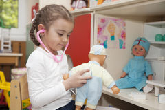 Little girl playing doctor Royalty Free Stock Photos