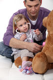 Little girl playing doctor Stock Photography