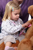 A little girl playing doctor Stock Photo