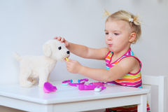 Little girl playing doctor indoors royalty free stock image