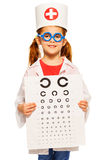 Little girl playing a doctor ophthalmologist Royalty Free Stock Photography