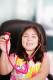 Little girl is playing doctor with stethoscope Royalty Free Stock Photos