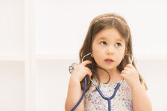 Little girl playing doctor with stethoscope Stock Images