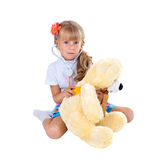 Little girl playing doctor with toy bear Stock Photos