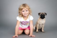 Little girl playing with dog Royalty Free Stock Photos