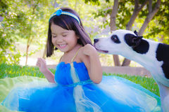Little girl playing with dog Stock Photography