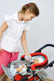 Little girl playing with doll Royalty Free Stock Photography