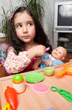 Little girl playing with doll Royalty Free Stock Photo