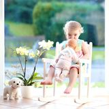 Little girl playing with doll Royalty Free Stock Photos