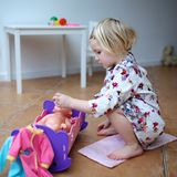 Little girl playing with doll Stock Photography