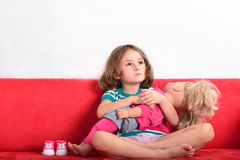 Little girl playing with a doll Royalty Free Stock Images