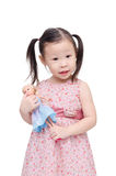 Little girl playing with doll over white Royalty Free Stock Photo