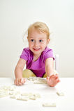 Little girl playing domino Stock Image