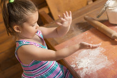 Little girl playing with dough Royalty Free Stock Photos