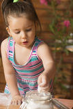 Little girl playing with dough Royalty Free Stock Images