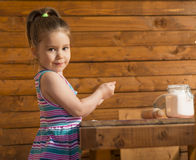 Little girl playing with dough Stock Photo