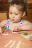 Little girl playing with dough Royalty Free Stock Image
